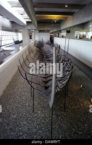 A Viking ship of the 11th century, discoverd in the Roskilde fjord in 1962, is presented in the ship hall of the - Stock Photo