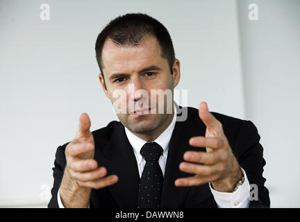 Thorsten Michalik, ETF (Exchange Traded Funds) Director of 'Deutsche Bank' gestures during an interview in Frankfurt - Stock Photo