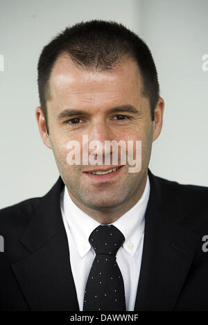 Thorsten Michalik, ETF (Exchange Traded Funds) Director of 'Deutsche Bank' smile in his office during an interview - Stock Photo