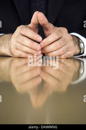 The photo shows the hands of Thorsten Michalik, ETF (Exchange Traded Funds) Director of 'Deutsche Bank' during an - Stock Photo