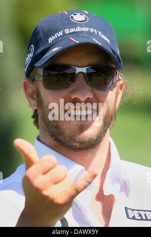 German Formula One pilot Nick Heidfeld of BMW Sauber team makes a gesture on a golf course near Valencia, Spain, - Stock Photo