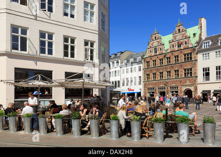 Outdoor café in old Amagertorv Square busy with people. Amager Torv, Copenhagen, Zealand, Denmark, Scandinavia - Stock Photo
