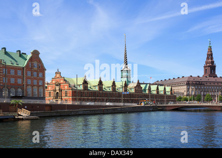 View across water to Copenhagen Old Stock Exchange Building Borsen and Christiansborg Palace on isle of Slotsholmen - Stock Photo