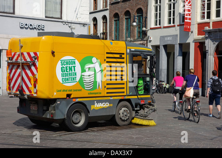 Street sweeper / street cleaner cleaning the streets in the city center of Ghent, Belgium - Stock Photo