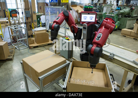 Baxter the robot made by Rethink Robotics at the Rodon Group plastic molding factory.  - Stock Photo