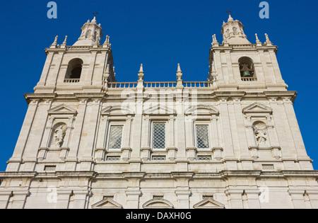 Monastery of Sao Vicente de Fora in Lisbon, Portugal. Facade shot over clear blue sky. - Stock Photo