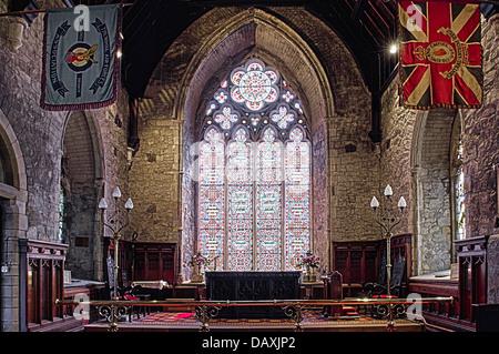 Stained Glass Windows inside Saint Nicholas Church of Ireland, Carrickfergus, which dates back to around 1182 - Stock Photo