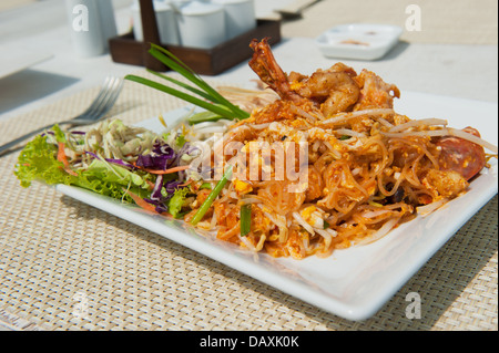 Pad Thai, stir fry noodles with shrimp, traditional Thai dish - Stock Photo