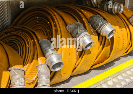 Hosepipes on the back of a fire engine - Stock Photo