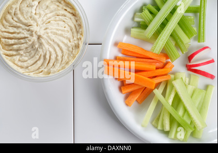 Houmous or Hummus with fresh vegetables - Stock Photo