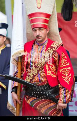 Unidentified member of military fanfare Mehter wears traditional Janissary costume during Turkish Festival, Bucharest, - Stock Photo