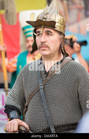 Member of traditional Janissary band wears metal war armor during Turkish Festival in Bucharest, Romania. - Stock Photo