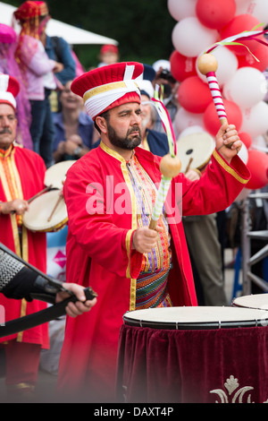 Unidentified member of traditional military Turkish band performs at drums during Turkish Festival, Bucharest, Romania. - Stock Photo