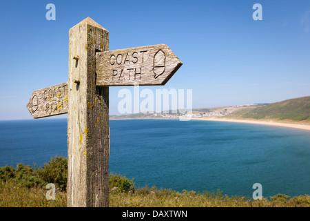 Coastal path with a sign, alongside Woolacombe beach in Devon, England. - Stock Photo