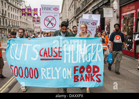 London, UK. 20th July, 2013. Protesters march along Regents Street as UK Uncut hold demonstrations outside two London - Stock Photo