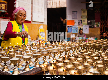 Woman burning oil lamps at diwali - Stock Photo