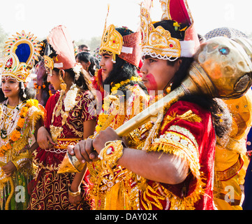 Artists dressed as Hindu mythological characters during a procession, Pushkar Camel Fair, Pushkar, Ajmer, Rajasthan, - Stock Photo