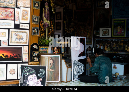 Local Artist painting canvas pictures which are sold to tourists, Pushkar, Ajmer, Rajasthan, India - Stock Photo