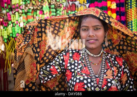 Portrait of a woman posing in traditional Rajasthani dress, Pushkar, Ajmer, Rajasthan, India - Stock Photo