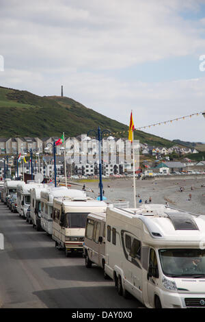 Aberystwyth, Wales, UK, 20 July 2013,  Camper van owners who park along Aberystwyth promenade make the most of the - Stock Photo