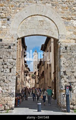 Porta San Giovanni and Via San Giovanni San Gimignano Tuscany Italy - Stock Photo