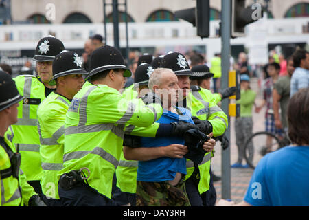 Birmingham, UK. 20th July 2013. Police scuffle with an EDL supporter. Credit:  Chris Gibson/Alamy Live News - Stock Photo