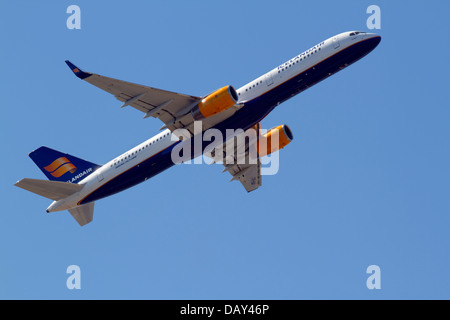 IcelandAir TF-ISK Boeing 757-200 takes off from CPH Kastrup Airport in Copenhagen, Denmark, one sunny summer afternoon. - Stock Photo