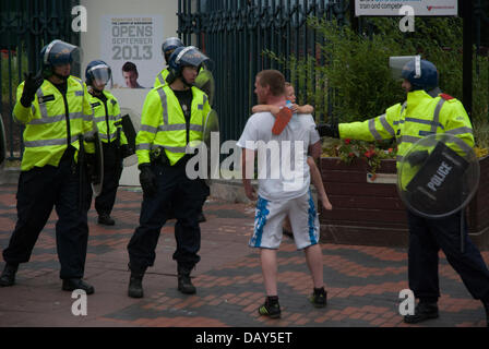 Birmingham, UK. 20th July, 2013. A child becomes extremely distressed as his father, an English Defence League protester, - Stock Photo