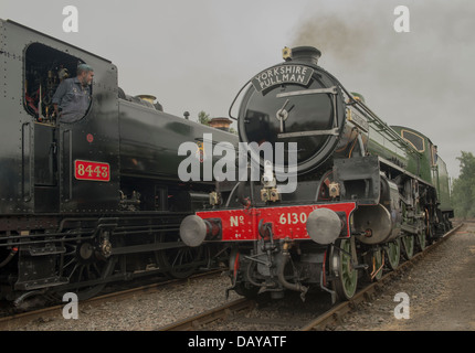 Two steam trains on the Mid Norfolk Railway. - Stock Photo