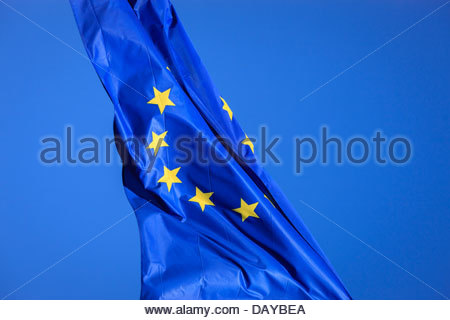 European Union Eu flag flying against blue sky - Stock Photo