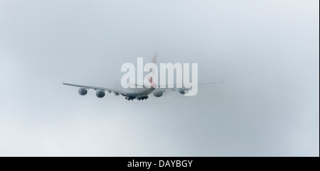 British Airways Airbus A380 lifts off from Manston Airport Kent. Enters low cloud on departure. - Stock Photo