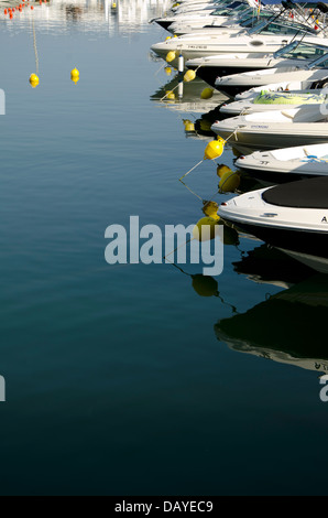 Row of yachts in the marina of Puerto banus in Marbella. Costa del Sol, Spain. - Stock Photo