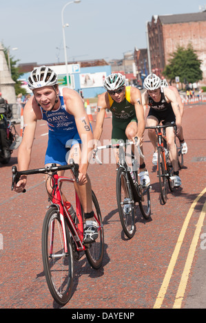 Men Elite Sprint Distance Triathlon supreme athletes super fit and fast drafting on the bike cycle leg cycling fast - Stock Photo