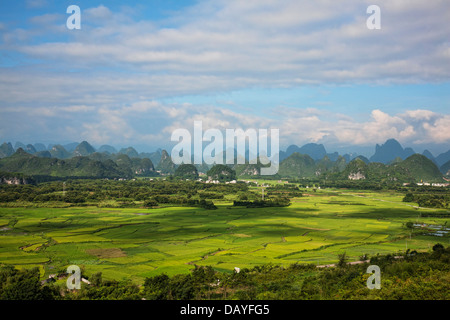 The beautiful countryside of Guilin, showing rice farms and Karst mountains. Guangxi Zhuang Autonomous Region, China - Stock Photo