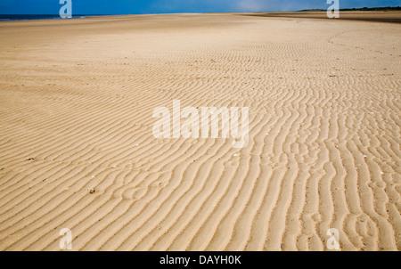Sandy empty beach sea Hunstanton, Norfolk, England - Stock Photo