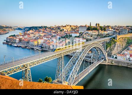View of the historic city of Porto, Portugal with the Dom Luiz bridge - Stock Photo