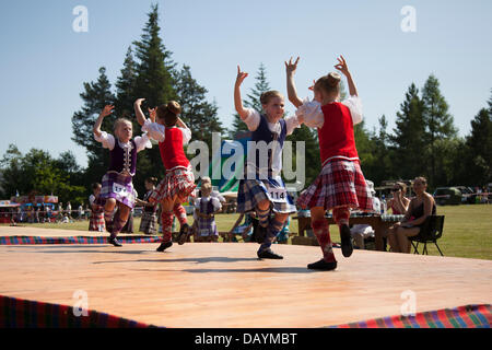Tomintoul, UK. 20th July, 2013. Highland reel dancers at the annual Tomintoul Scottish games and gathering held - Stock Photo
