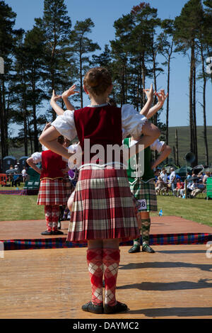 Tomintoul, UK. 20th July, 2013. Traditional Highland reel dancers at the annual Tomintoul Scottish games and gathering - Stock Photo