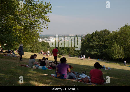 London, UK. 21st July, 2013. Beautiful summer weather draws the crowds to the Alexandra Park 150th birthday party, - Stock Photo