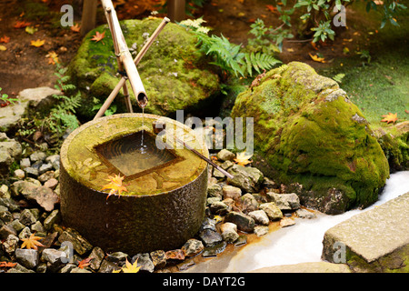 Tsukubai for hand washing in Kyoto, Japan. - Stock Photo