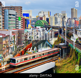 Subway enters a tunnel at Ochanomizu district of Tokyo, Japan. - Stock Photo