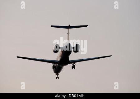 BMI Regional Embraer EMB-145 landing at Birmingham Airport, UK - Stock Photo