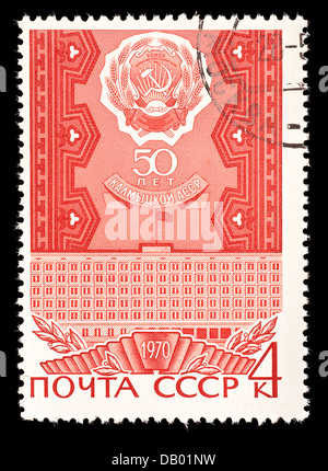 Postage stamp from Soviet Union depicting the hammer and sickle and the Elista in Kalmyk - Stock Photo