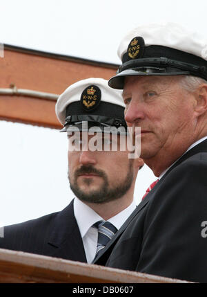 King Harald V of Norway (R) and Crown Prince Haakon of Norway (L) pictured aboard the royal yacht 'Norge' arriving - Stock Photo
