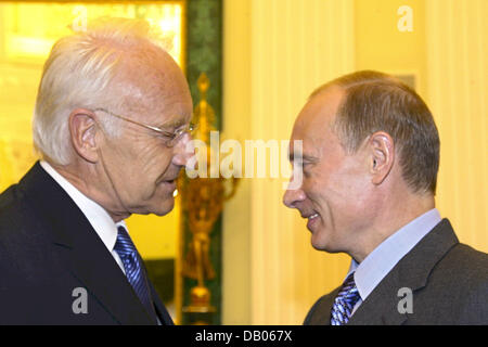 Bavarian Prime Minister Edmund Stoiber (L) is welcomed by Russian president Vladimir Putin in the Kremlin in Moscow, - Stock Photo