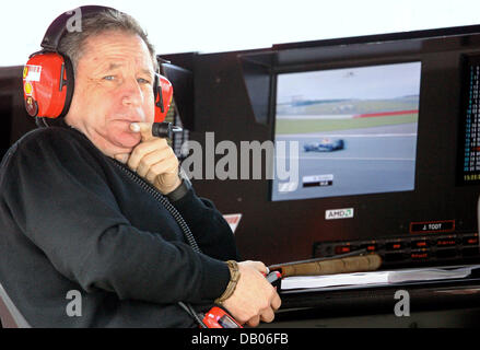 French CEO of Scuderia Ferrari Jean Todt watches Practice 2 to the British Grand Prix at Silverstone Circuit in - Stock Photo