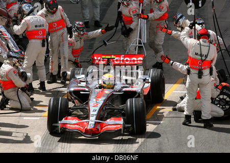 British Formula One driver Lewis Hamilton of McLaren Mercedes is pictured during a pit stop at the British Grand - Stock Photo