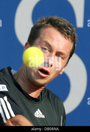 German tennis pro Philipp Kohlschreiber focusses the ball in his round of last sixteen match against Spanish Rafael - Stock Photo