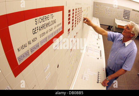 Kai Detlefsen, coach for reactor operators stands in an exact simulator of the reactor control stand at the nuclear - Stock Photo