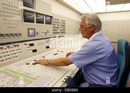 Kai Detlefsen, coach for reactor operators sits in an exact simulator of the reactor control stand at the nuclear - Stock Photo